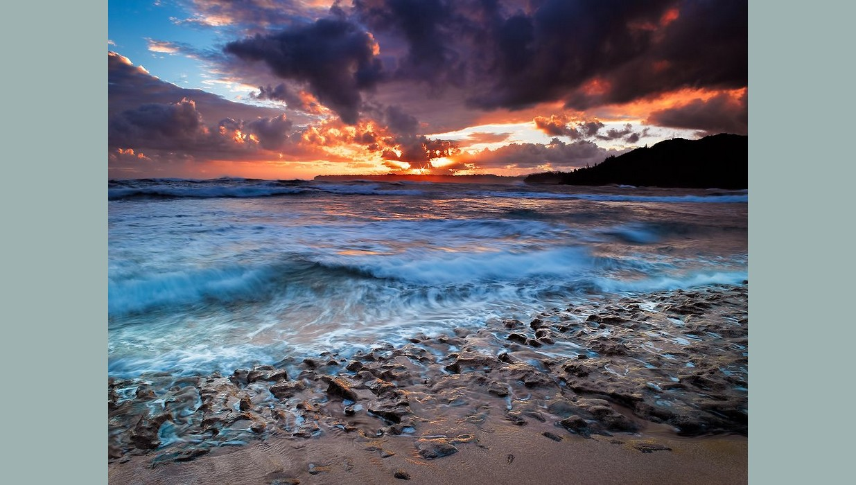 Kauai Sunrise shore rocks.jpg